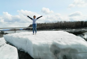 Ermelina, on top of a ice chunk at Susitna River in southcentral Alaska by Angela Gonzalez