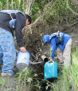 My nephews, Marvin Jr. and Brandon, collect mountain water along the Koyukuk River in 2011. Photo by Angela Gonzalez