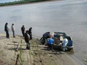 Huslia men help put my dad's boat in the water in 2011. Photo by Angela Gonzalez