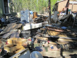 Debris from flooding is gathered for dumping. Photo by Molissa Bifelt
