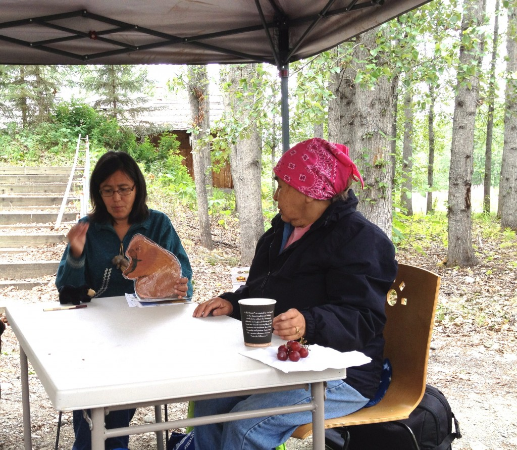 Susan Paskvan and Eliza Jones telling story in Denaakk'e. Photo by Angela Gonzalez