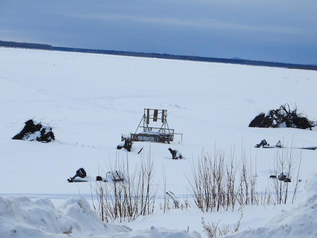 A fish wheel sits in the frozen Yukon River by Nulato. Photo by Martha Demoski