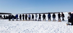Contestants line up for the start of the Men's Snowshoe Race. Photo by Danielle Ballard Huffman