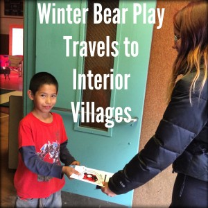 Ashton Williams hands out programs for the Winter Bear play in Huslia. Photo by Angela Gonzalez