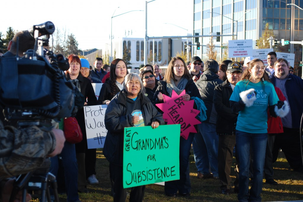 "Supporters of Alaska Native hunting and fishing rights gathered for the Hunt Fish Share and Vote Rally in Anchorage on Oct. 22. One Elder carried a ""Great Grandma's for Subsistence"" sign. Photo by Angela Gonzalez"