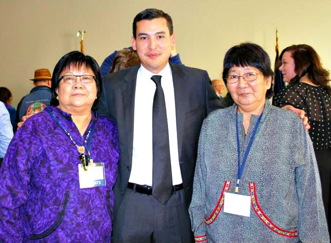 Koyukon Athabascan speakers Esther McCarty, Freddie R. Olin IV and Ella Sam celebrate after the Alaska Native language bill becomes law. Photo by Angela Gonzalez