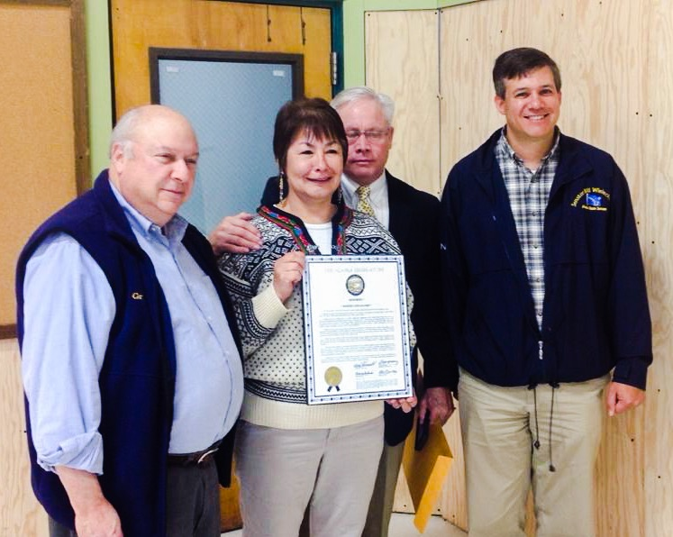 Representative Max Gruenberg and Senator Bill Wielechowski presented Martha Gould-Lehe with a plaque in recognition for her contributions toward public education in Alaska. Left-right: Representative Max Gruenberg, Martha Gould Lehe, John Lehe, and Senator Bill Wielechowski. Photo by Robert Strick