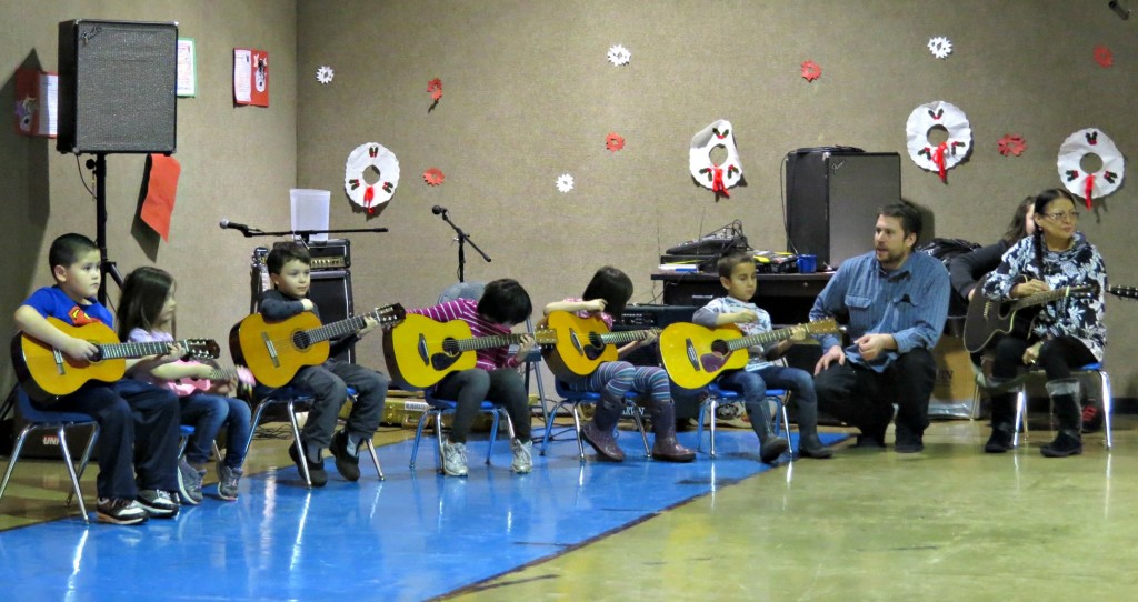 Guitar lessons for youth in Nikolai. Photo by Amy Modig