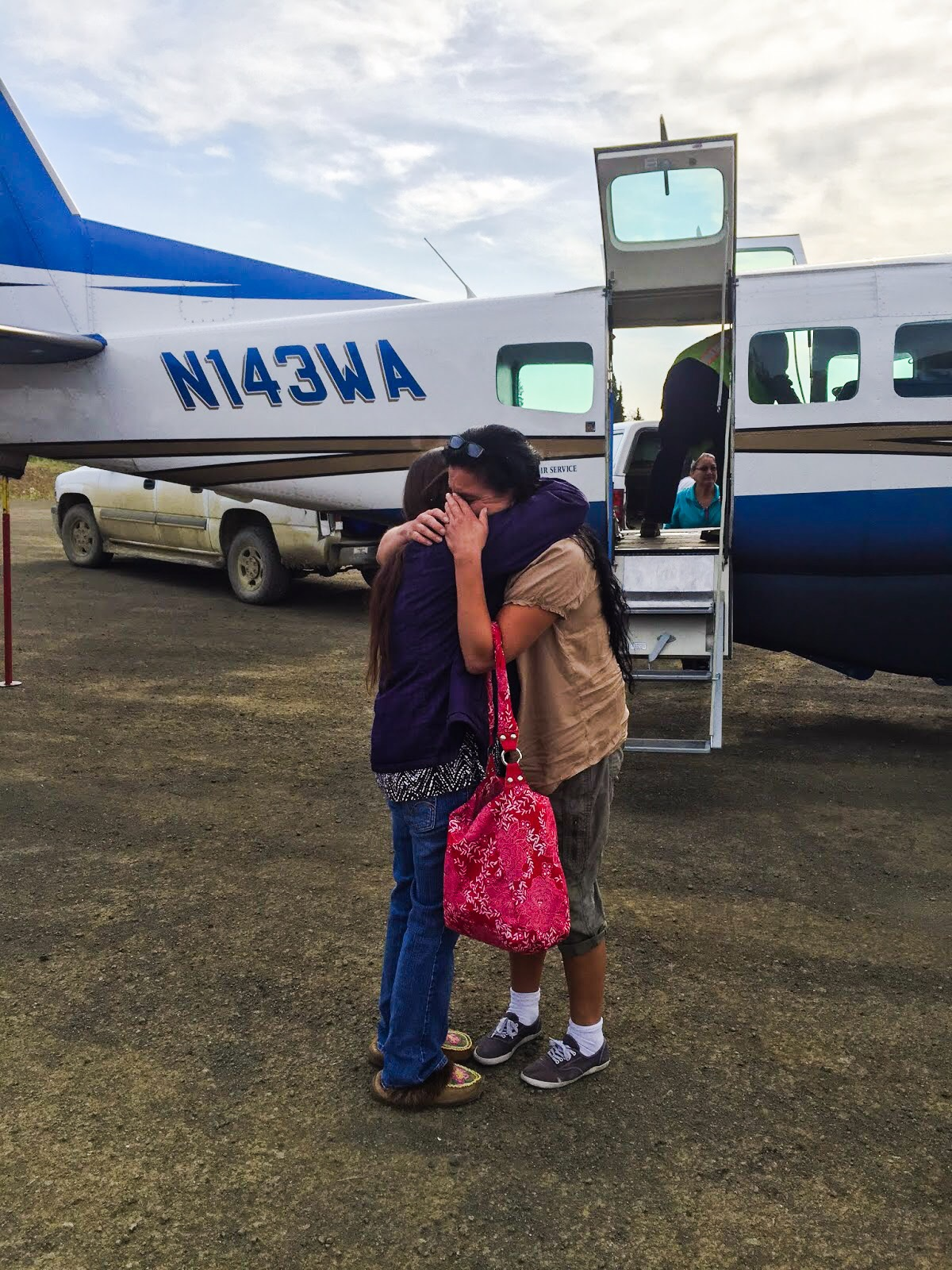 Mary St. Martin-Charles is greeted by family in Koyukuk in the summer of 2015. Courtesy photo