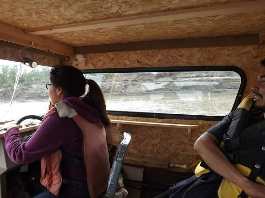 Dorothy Williams and her dad, Joey Williams driving along the Koyukuk River. Photo courtesy of Dorothy Williams.