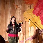 Tanaya Winder reading a poem. Photo by Angela Gonzalez